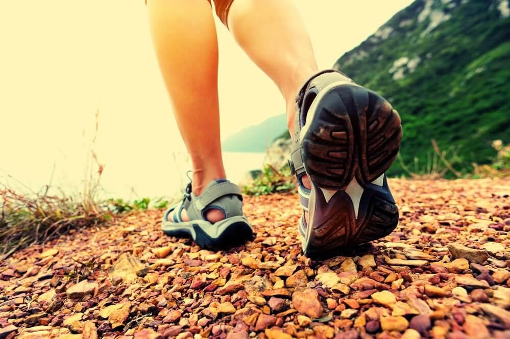 Woman hiker hiking on seaside trail