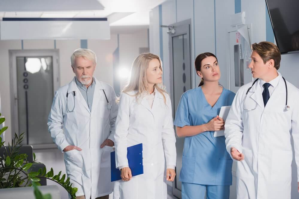 Selective focus of doctor talking while walking