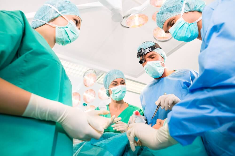 Surgeons in operating room in emergency